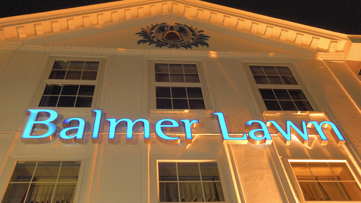 At night the lettering really comes alive, beautifully complimented with soft ground mounted up-lighting.