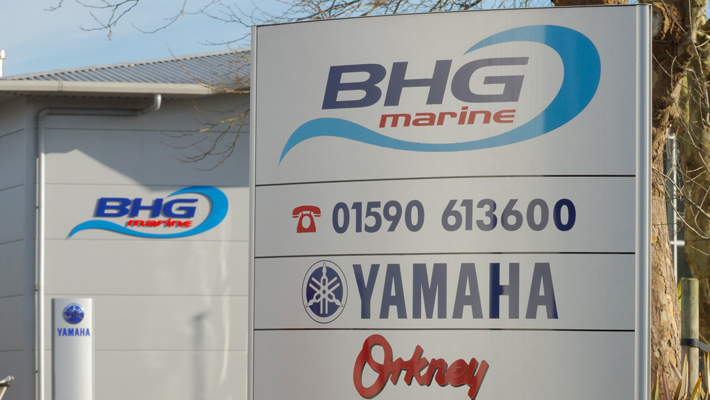 In the foreground and background small (2m high) aluminium monolith signs. An ideal site marker or directory solution.