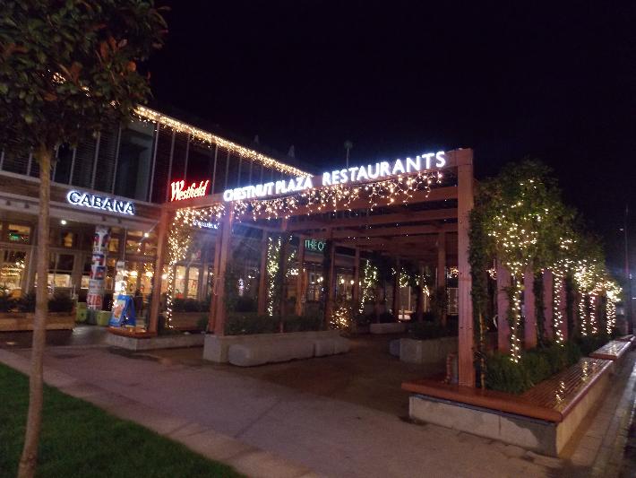 Night view of pergola freestanding logo and face mounted acrylic LED illuminated lettering.