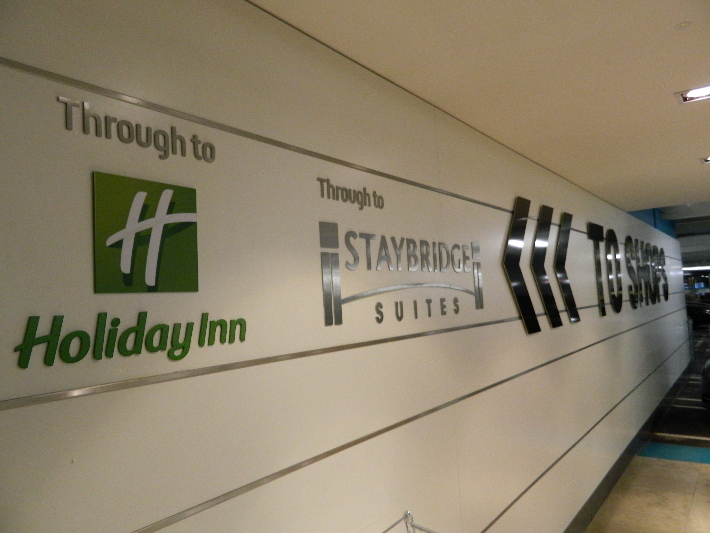 Laser cut stainless steel and powder coated wayfinding logos and arrows