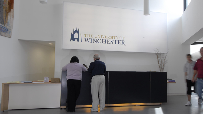 Above the main reception desk is a large printed flex face (banner material) internally illuminated light-box.