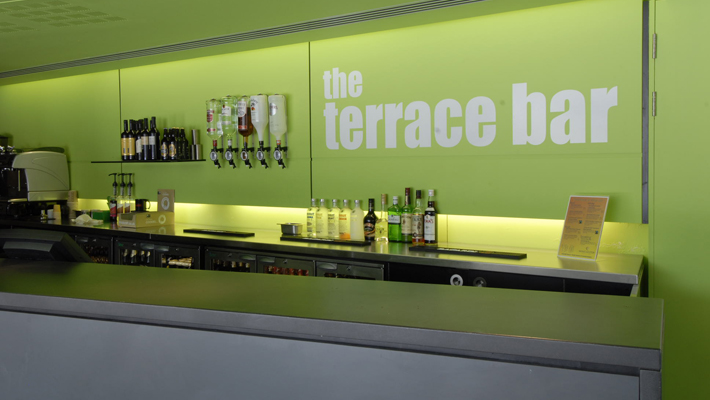 """""""The terraced bar"""" text, one of the 50 or so self adhesive vinyl graphics applied directly to painted walls around the centre. An extremely cost effective way of designating different areas in a larger building."""