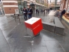 View of bespoke wayfinding street cube, fabricated from stainless steel and vitreous enamel c/w updateable mapping system.